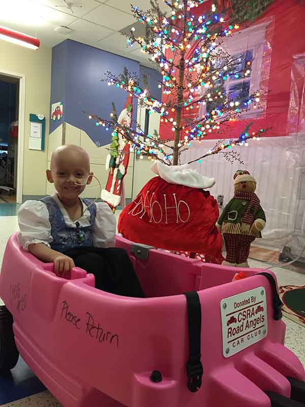 Chayenne, on Christmas Eve, cruises in her pink wagon donated by the CSRA Road Angels to the Children's Medical Center.